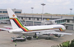 Plane at airport Air Zimbabwe Bargain Flights